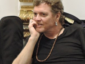 Rick Allen, longtime drummer for Def Leppard, listens to some stories from fans during an appearance Aug. 31, 2015, at Wentworth Gallery in King of Prussia, PA. (Photo by Mike Morsch)