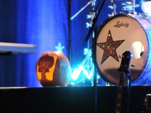 A jack-o-lantern featuring Ringo's cartoon character sits next to his drum set.  (Photo by Mike Morsch)