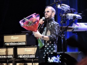 Ringo Starr admires the flowers given to him by a fan at his show Oct. 30, 2015, at the Tower Theater in suburban Philadelphia. (Photo by Mike Morsch)