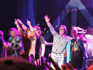 All-Starr band members, including Todd Rundgren and his funky concert attire, second from right, acknowledge the cheers of an appreciative crowd after the show. (Photo by Mike Morsch)