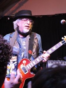Brad Whitford, guitarist for Aerosmith, gets into the Whitford St. Holmes performance Sunday night.  (Photo by Mike Morsch)