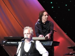 Eric Troyer plays the keyboards, top, as former Styx guitarist Glen Burtnik , foreground, belts out vocals during the show. (Photo by Mike Morsch)