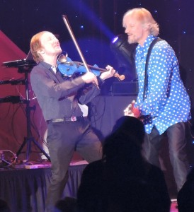 ELO violinist Mik Kaminski, with his trademark blue violin, rocks with guitarist Parthenon Huxley at a concert by The Orchestra Jan. 2 at Resorts Casino Hotel in Atlantic City. (Photo by Mike Morsch)