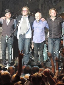 Band members and Frampton take a bow after the show. From left to right are Adam Lester, Paul Peterson, Frampton and Rob Arthur. Not pictured is drummer Dan Wojciechowski. (Photo by Mike Morsch)