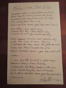 """A lyric sheet of """"Baby, I Love Your Way,"""" with Frampton's signature in the lower righthand corner. (Photo by Mike Morsch)"""