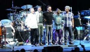 Steve Wijnrood, left, and his band take a bow after their set opening for Steely Dan. (Photo by Mike Morsch)