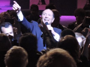 Fans surround Paul Anka as he comes into the audience to sing. (Photo by Mike Morsch)