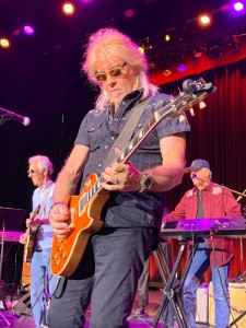 "Peter Beckett of Player, center, rocks out to ""Rock and Roll"" by Led Zeppelin, during the encore with Elliot Lurie, left, and John Ford Coley, right, at the Yacht Rock 2019 show Aug. 23 at the Borgata in Atlantic City.  (Photo by Mike Morsch)"