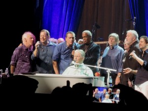 "Everyone gathered around Brian Wilson at the piano for the final song of the evening, ""Love and Mercy."" (Photo by Mike Morsch)"